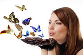 Woman with flying butterflies. — Stock Photo