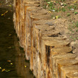 Wooden strengthening of quay — Stock Photo