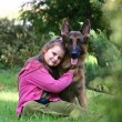The girl and a German shepherd - Stock Photo