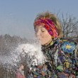 The young woman blow the snow - Stock Photo