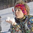 Stock Photo: The young woman blow the snow