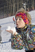 The young woman blow the snow — Stock Photo