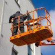 Woker washing a wall — Stockfoto