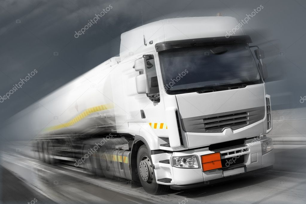 Speeding truck with fuel tank low saturation,photoshop modified image — Stock Photo #1142935