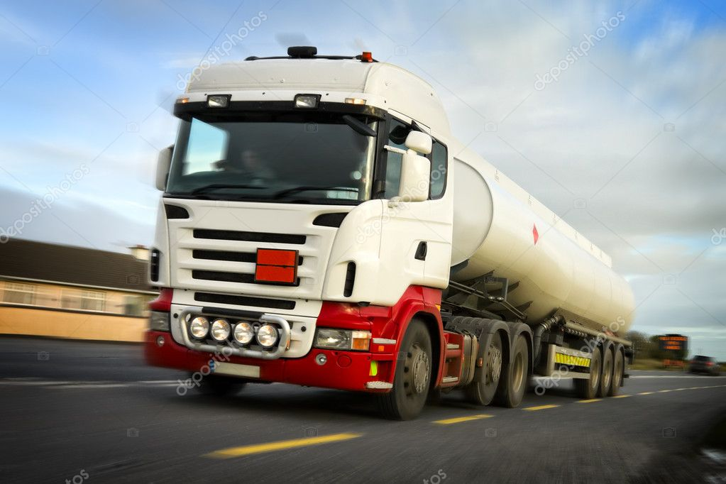 Fuel truck in motion on the busy country road,Photoshop modified image — Stock Photo #1174526