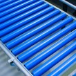 Cylinder conveyor detail - Stock Photo