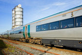 Train in and fuel tanks — Stock Photo