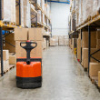 Stock Photo: Industrial warehouse and forklift