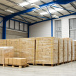 Royalty-Free Stock Photo: Pallets with cartons in warehouse