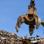 Crane grabber up on the metal heap — Stock Photo #1237135