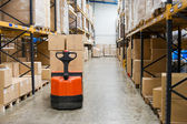 Industrial warehouse and forklift — Stock Photo