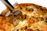 Seafood pizza and cutter close-up — Stock Photo