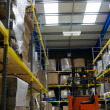 Industrial warehouse and forklift — Foto de Stock