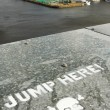 Jump here sign - Stock Photo