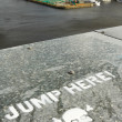 Jump here sign — Stockfoto