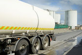 Fuel track leaving industrial zone — Stock Photo