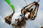 Crane grabber loading recycling steel — Stock Photo