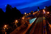 Train station in the dusk and new moon — Stock Photo