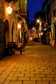 Old street decorated with lights — Stock Photo