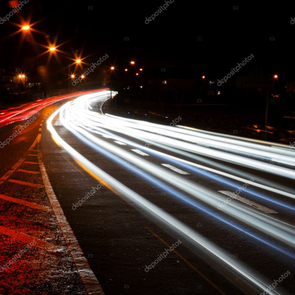 Car lights trails and road marks at night city street — Stock Photo #1388971