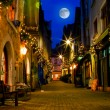 Old street with lights at night - Stock Photo
