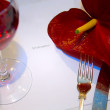 Glass of wine and red flower - Stock Photo