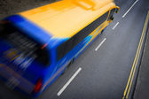 Bus in motion — Stock Photo