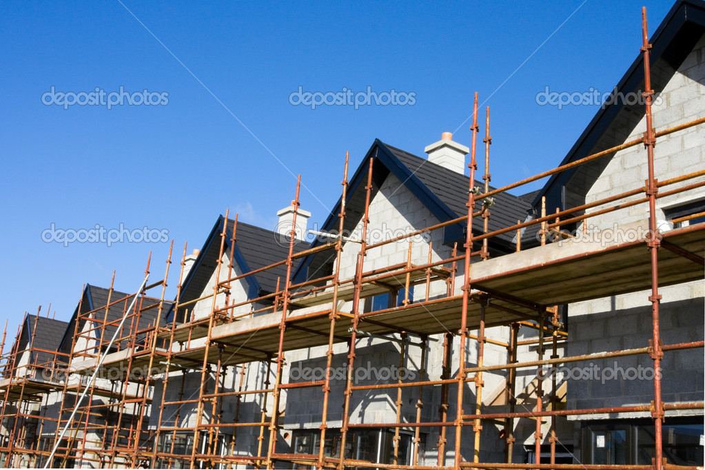 Raw of houses roofs with scuffolds  in construction site — Stock Photo #2585458