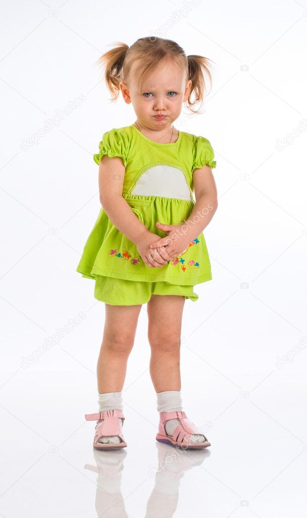 Sad little girl isolated on a white  Foto de Stock   #1182211
