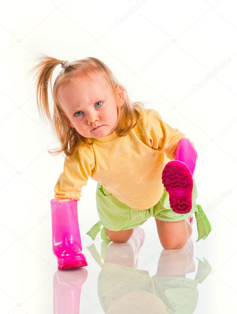 little girl with rubber boots on hands — Stock Photo #1182228