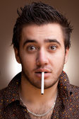 Funny portrait of man with a cigarette — Stock Photo
