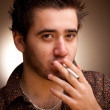 Funny portrait of man with a cigarette — Stock Photo #1194719