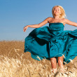 Woman Jump in the field - Stock Photo