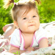 Baby portrait on the grass — Stok fotoğraf