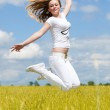 Girl jump in the field — Stock Photo
