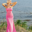 Beautiful girl in a long pink dress. - Stock Photo