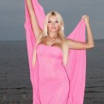 Beautiful girl in a long pink dress. — Stock Photo #1211035