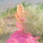 Beautiful girl in a long pink dress. — Stock Photo #1211083