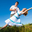 Cople dancing outdoors — Stock Photo