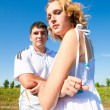 Couple standing outdoors. Focus on girl. — Stock Photo #1219501
