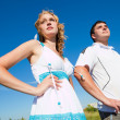 Couple standing outdoors — Stock Photo #1219518
