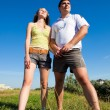Couple outdoors on a summers day - Stock Photo