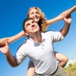 Couple fooling around outdoors — Stock Photo #1219688