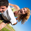 Stock Photo: Couple fooling around outdoors