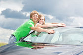 Teens at the car in the field — Stock Photo