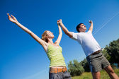 Couple standing outdoors smiling — Stock Photo