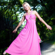 Woman in pink dress — Stock Photo