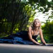 Beautiful woman on the road in forest — Stock Photo