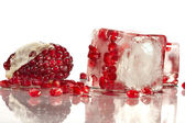Pomegranate in ice — Stock Photo