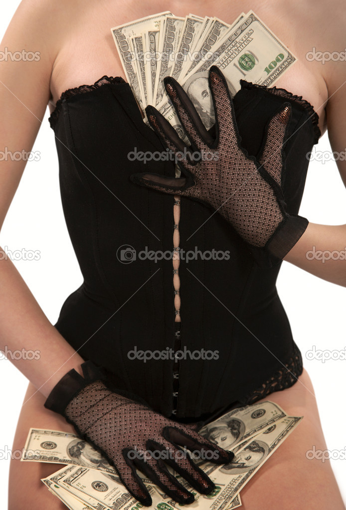 Girl in a black corset counts banknotes of dollars — Stock Photo #2415633
